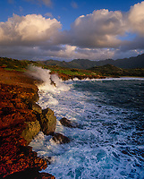 Waves crashing against Makawehi Bluff, Poipu, Kauai, Hawaii, USA.