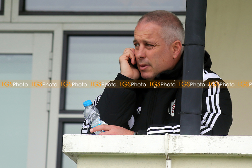 Fulham's caretaker manager, Kit Symons, takes a call on his mobile phone - Fulham Under-21 vs Liverpool Under-21 - Barclays Under-21 Premier League Football at Motspur Park Training Ground, Surrey - 26/10/14 - MANDATORY CREDIT: Paul Dennis/TGSPHOTO - Self billing applies where appropriate - contact@tgsphoto.co.uk - NO UNPAID USE