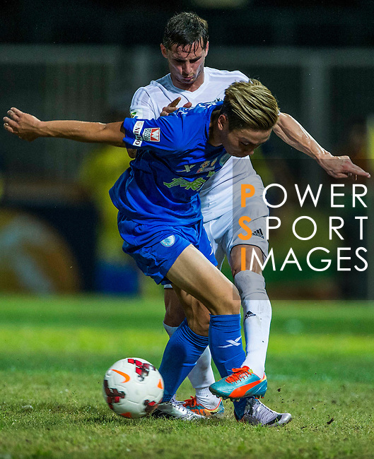 (L) Pablo Piatti of Valencia CF competes for the ball with (R) You Kwok Chuck of BC Ranger FC LFP World Challenge 2014 between Valencia CF vs BC Rangers FC on May 28, 2014 at the Mongkok Stadium in Hong Kong, China. Photo by Victor Fraile / Power Sport Images