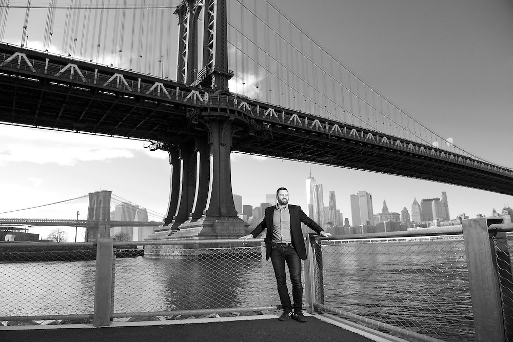 The CEO of a wind energy company based in DUMBO Brooklyn photographed along the waterfront in Brooklyn Bridge Park.
