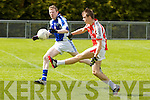 Pictured on Sunday for the Castleisland Mart Junior County Championship Quarter-Final, Brosna V Templenoe in Pairc na Feile Brosna. <br /> Brosna's Timmy Finnegan plays the ball forward while being closed down by Templenoe's Kieran O'Neill.