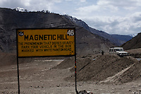 The Magnetic Hill on the Srinagar-Leh Highway, a.k.a. National Highway 1D is a gravity hill located near Leh in Ladakh, India. The hill is alleged to have magnetic properties strong enough to pull cars uphill and force passing aircraft to increase their altitude in order to escape magnetic interference; in reality, the effect is an optical illusion created by the gravity hill..*Pre-season Jeep road trip from Delhi to Amritsar, Srinagar, Kargil, Lamayuru, Leh, Khardung La, Tso Moriri and back to Delhi in May 2010. Photo by Suzanne Lee