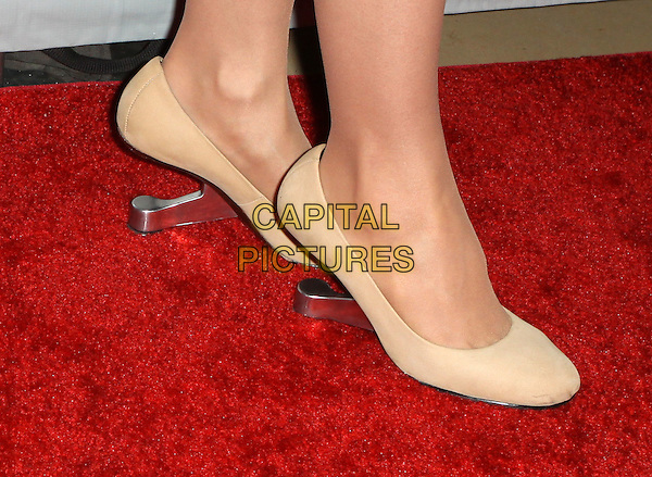 "SARAH SILVERMAN'S SHOES .L.A. Gay & Lesbian Center's ""An Evening With Women -Inside held At The Beverly Hilton Hotel, Beverly Hills, California, USA, 1st May 2010. .detail no heels heel feet silver beige shoes heels metal.CAP/ADM/FS.©Faye Sadou/AdMedia/Capital Pictures."