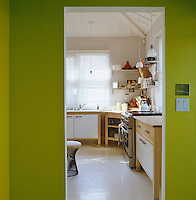 View from the acid green hallway into the kitchen