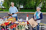 Mary Kelly from Caherslea getting her veg from Aidan O'Connor from the Maherees on Saturday morning at the Farmers Market in Tralee