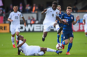 February 2nd 2019, San Jose, California, USA; Costa Rica defender Pablo Arboine (3) slide tackles the ball away from USA midfielder Paul Arriola (14) and Costa Rica defender Keysher Fuller (4) during the international friendly match between USA and Costa Rica at Avaya Stadium on February 2, 2019 in San Jose CA.