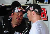 May 1, 2009; Richmond, VA, USA; NASCAR Sprint Cup Series driver Dale Earnhardt Jr (right) with crew chief Tony Eury Jr during practice for the Russ Friedman 400 at the Richmond International Raceway. Mandatory Credit: Mark J. Rebilas-