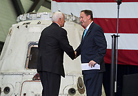 In this photo released by the National Aeronautics and Space Administration (NASA) United States Vice President Mike Pence shakes hands with Acting NASA Administrator Robert Lightfoot before addressing NASA employees, Thursday, July 6, 2017, at the Vehicle Assembly Building at NASAís Kennedy Space Center (KSC) in Cape Canaveral, Florida. The Vice President thanked employees for advancing American leadership in space, before going on a tour of the center that highlighted the public-private partnerships at KSC, as both NASA and commercial companies prepare to launch American astronauts from the multi-user spaceport. Photo Credit: Aubrey Gemignani/NASA/CNP/AdMedia