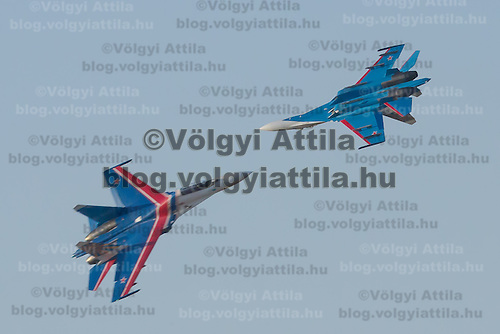 International Air Show at the Hungarian Air Force base in Kecskemet (about 87 km South-East of the capital city Budapest), Hungary on August 03, 2013. ATTILA VOLGYISZU-27 aircrafts of the Russkye Vityazi squadron from the Russian Airforce perform during the