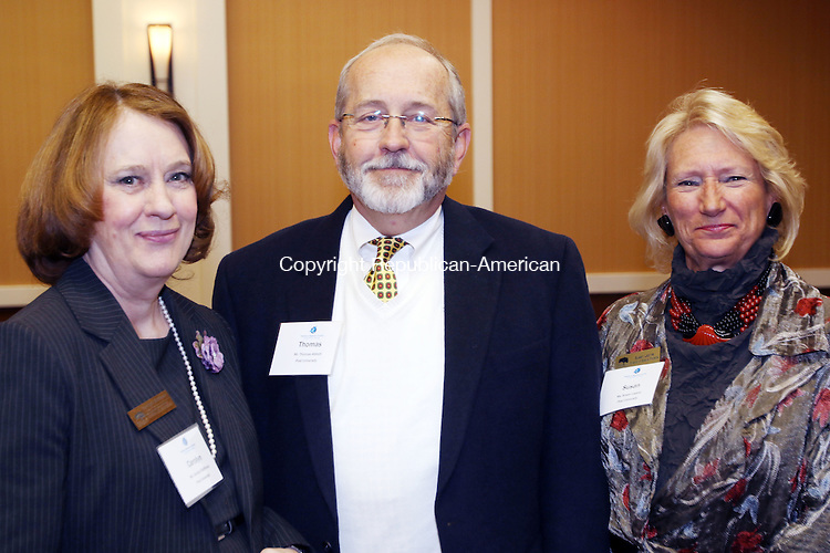 WATERBURY CT. 20 November 2015-112015SV10-From left, Carolyn Shiffman, Thomas Abbott, and Susan Lapine all of Post University attend A Book Launch Celebration for the release of &quot;Mac Baldrige: The Cowboy in Ronald Reagan's Cabinet,&quot; by Black and Cooper in Waterbury Friday. The event was co-sponsored by the Post University Malcolm Baldrige School of Business and the Waterbury Chamber.<br /> Steven Valenti Republican-American