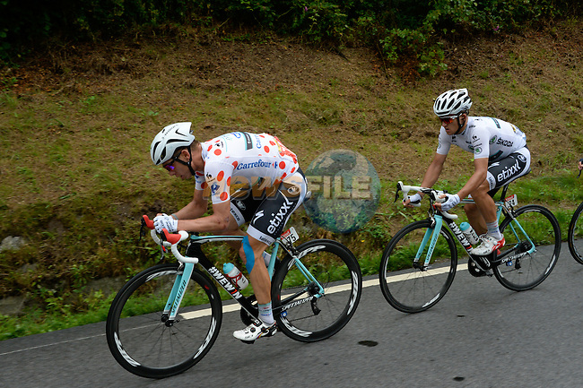 Tony Martin (GER) brings Omega Pharma-Qiuck Step team mate Michal Kwiatkowski (POL) to the head of the breakaway group during Stage 10 of the 2014 Tour de France running 161.5km from Mulhouse to La Planche des Bellles Filles. 14th July 2014.<br /> Photo ASO/B.Bade/www.newsfile.ie