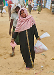 A Rohingya woman carries food supplies she received from Dan Church Aid in the Jamtoli Refugee Camp near Cox's Bazar, Bangladesh. Dan Church Aid is a member of the ACT Alliance.<br /> <br /> More than 600,000 Rohingya have fled government-sanctioned violence in Myanmar for safety in Bangladesh.