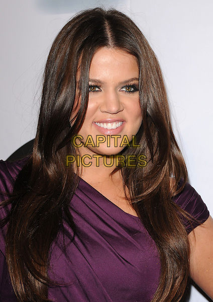 KHLOE KARDASHIAN.at The Famous Cupcakes Beverly Hills Grand Opening, Beverly Hills, California, USA, October 7th,2009..portrait headshot  purple one sleeve smiling ruched .CAP/DVS.©DVS/RockinExposures/Capital Pictures.