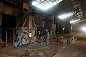 Indonesia - Bangka Island - Mentok - Workers processing tin at the PT Timah smelting factory. In 2012 PT Timah produced slightly more than 28,000 tons of tin, 97 percent of which was exported.