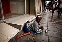 A man with problems in his hips begs for money in a street in Bogota, Colombia. 29/02/2012.  Photo by Eduardo Munoz Alvarez / VIEWpress.