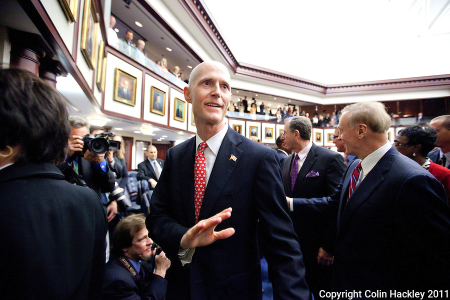 TALLAHASSEE, FLA. 3/8/11-OPENINGDAY030811 CH-Gov. Rick Scott waves to lawmakers as he leaves the House Chamber after giving the State of the State address Tuesday at the Capitol in Tallahassee..COLIN HACKLEY PHOTO