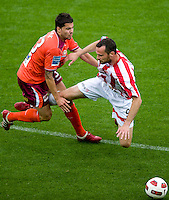 MELBOURNE, AUSTRALIA - NOVEMBER 14: Gerald Sibon of the Heart challenges Milan Susak of the Roar during the round 14 A-League match between the Melbourne Heart and Brisbane Roar at AAMI Park on November 14, 2010 in Melbourne, Australia (Photo by Sydney Low / Asterisk Images)