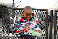 A young boy holds up a commemorative Obama flag prior to the inauguration of Barack Obama as 44th President of the United States of America, Monday, Jan. 19, 2009, in Washington, D.C. (Marisa McGrody/pressphotointl.com)