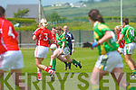 A fine effort from Kerrys Laura Rogers as she threads her way through the Cork defense of Annie Walsh and Brid Stack.