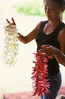 Woman with pink and white Plumeria leis