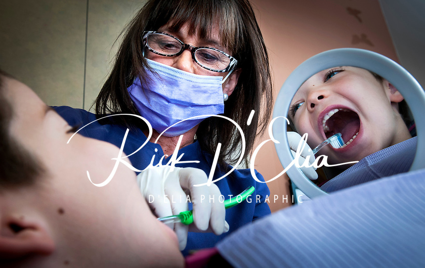 Dr. Pnina Levine looks over Benjamin Koch's teeth and talks to him about proper and complete brushing and taking good care of his mouth.
