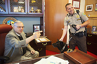 "USA. Arizona state. Phoenix. The sheriff Joe Arpaio in his office with a police officer and his dog from the canine unit. Joseph Michael ""Joe"" Arpaio (born June 14, 1932) has, since 1993, been the elected sheriff of Maricopa County, Arizona.  Arpaio styles himself as ""America's Toughest Sheriff.""  25.01.16 © 2016 Didier Ruef"