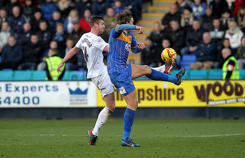 Preston North End's Paul Huntington battles with  Shrewsbury Town's Tom Eaves<br />