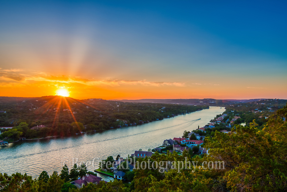 This is another capture from Mt. Bonnel in Austin at sunset. This scenic vista overlook Lake Austin and the city of Austin. It is a great spot for locals and tourist to watch the sunset looking west towards the Pennybacker Bridge or looking east to the downtown skyline. The walk up the stair can be a little difficult for some but it is worth the view. You can take a picnic and enjoy the view of the city or the sunset.