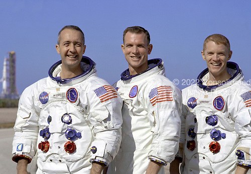 "Kennedy Space Center, FL - December 18, 1968 -- Portrait of the Apollo 9 prime crew in their space suits. From left to right: Commander, James A. McDivitt, Command Module pilot, David R. Scott, and Lunar Module pilot, Russell L. Schweickart. The Apollo 9 mission was designed to test the Apollo Command/Service and Lunar Modules in Earth orbit. The purpose was to verify that the Command/Service Module (CSM) could successfully dock with the Lunar Module (LM). The mission was also to test the LM systems in a ""free flying"" attitude to ensure that it performed as per specifications. .Credit: NASA via CNP"