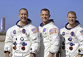 """Kennedy Space Center, FL - December 18, 1968 -- Portrait of the Apollo 9 prime crew in their space suits. From left to right: Commander, James A. McDivitt, Command Module pilot, David R. Scott, and Lunar Module pilot, Russell L. Schweickart. The Apollo 9 mission was designed to test the Apollo Command/Service and Lunar Modules in Earth orbit. The purpose was to verify that the Command/Service Module (CSM) could successfully dock with the Lunar Module (LM). The mission was also to test the LM systems in a """"free flying"""" attitude to ensure that it performed as per specifications. .Credit: NASA via CNP"""