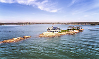 BNPS.co.uk (01202 558833)<br /> Pic: ChristiesInternational/BNPS<br /> <br /> The tiny island boasts a 4000 sq ft solar powered home along with a swimming pool and gardens.<br /> <br /> SpudULike? - Fancy cashing in your chips and moving to Potato Island near New York.<br /> <br /> The tiny 1 acre island has just come on the market, but you may need to find the legendary treasure of Captain Kidd first before you can afford the £3.8 million asking price.<br /> <br /> The 17th century British pirate is said to have buried his loot somewhere nearby although to this day it remains unfound.<br /> <br /> 'Potato' is part of the tiny Thimble island group situated just off the coast of Branford in Long Island Sound.<br /> <br /> And despite its seemingly remote location it is only 85 miles from New York City.