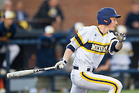 Michigan Wolverines third baseman Jimmy Kerr (15) follows through on his swing against the Eastern Michigan Hurons on May 3, 2016 at Ray Fisher Stadium in Ann Arbor, Michigan. Michigan defeated Eastern Michigan 12-4. (Andrew Woolley/Four Seam Images)