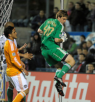 Chicago goalkeeper Andrew Dykstra (40) makes a leaping save in front of Houston's Luis Landin (7).  The Chicago Fire defeated the Houston Dynamo 2-0 at Toyota Park in Bridgeview, IL on April 24, 2010.