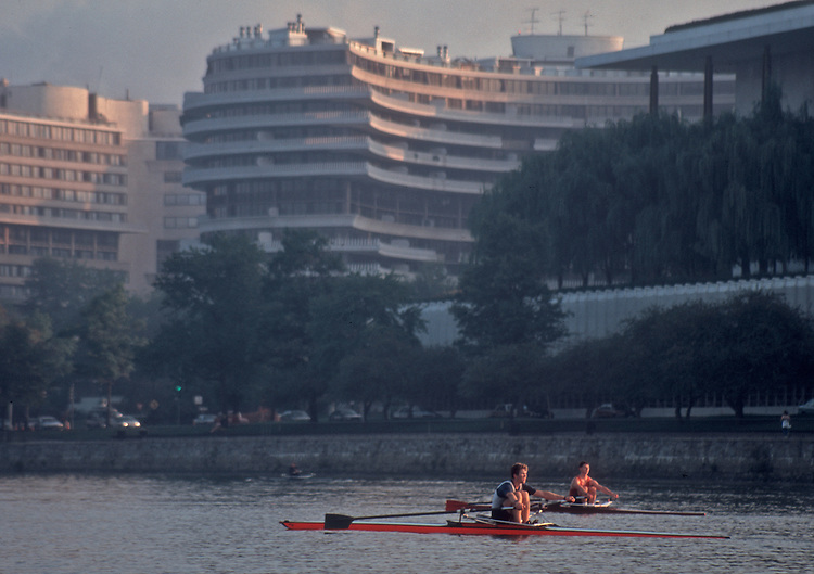 Rowing, Washington DC, Potomac Boat Club single scullers in sinlge racing shells, passing The Watergate on the Potomac River, .