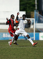 09 February, 2005. Trinidad and Tobago's Brent Sancho (5) tries to defend against Eddie Johnson (9) during the World Cup qualifier at Queen's Park Oval in Port of Spain, Trinidad and Tobago.  The USMNT defended Trinidad and Tobago 2-1.