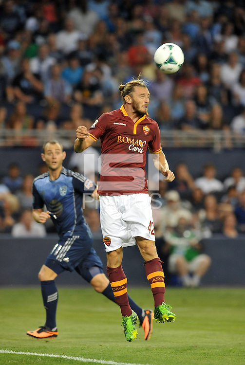 Sporting Park, Kansas City, Kansas, July 31 2013:<br /> Federico Balzaretti (42) defender AS Roma heads the ball away.<br /> MLS All-Stars were defeated 3-1 by AS Roma at Sporting Park, Kansas City, KS in the 2013 AT & T All-Star game.