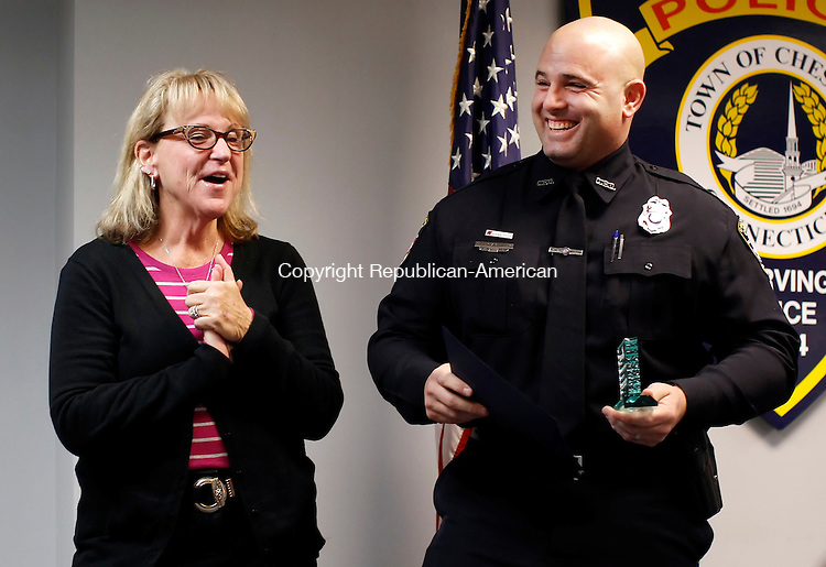 Cheshire, CT-13 December 2012-121312CM02-  Cheshire police officer Joe Giampietro, right receives the Hilda Davis Achievement Award from Janice Heggie Margolis. Director of Victim Services at MADD (Mothers Against Drunk Driving) during an awards ceremony Thursday afternoon at the Cheshire Police Department.      Christopher Massa Republican-American