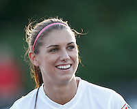 Portland Thorns FC forward Alex Morgan (13). In a National Women's Soccer League (NWSL) match, Boston Breakers (blue) defeated Portland Thorns FC (white/black), 2-1, at Dilboy Stadium on August 7, 2013.