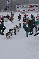Daniel Wilbert  leaves the start line of the 2006 Jr. Iditarod race from Willow Lake, Alaska   ..Photo by Ben Schultz