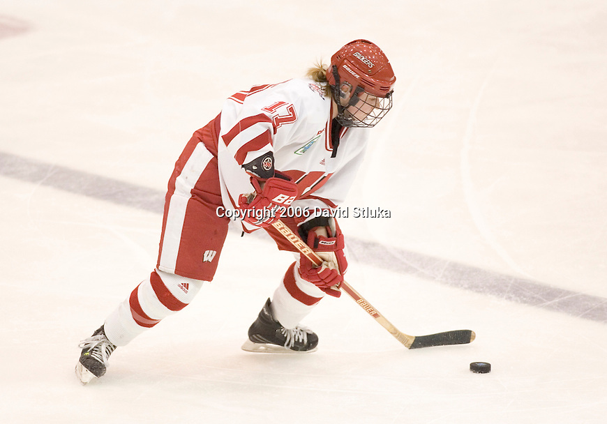 MINNEAPOLIS, MN - MARCH 26: Kristen Witting #17 of the Wisconsin Badgers handles the puck against the Minnesota Golden Gophers at Mariucci Arena during the Women's Frozen Four Tournament final on March 26, 2006 in Minneapolis, Minnesota. The Badgers beat the Gophers 3-0. (Photo by David Stluka)