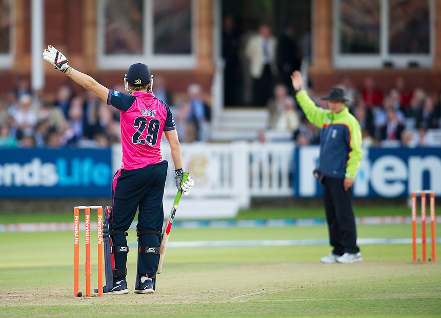 Middlesex Panthers' Dawid Malan  and umpire Richard Kettleborough<br /> <br />  (Photo by Ashley Western/CameraSport) <br /> County Cricket - Friends Life t20 2013 - Middlesex v Essex - Thursday 04th July 2013 - Lord's, London <br /> <br />  &copy; CameraSport - 43 Linden Ave. Countesthorpe. Leicester. England. LE8 5PG - Tel: +44 (0) 116 277 4147 - admin@camerasport.com - www.camerasport.com