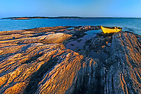 yellow kayak on shoal of Walton Island at sunrise on Georgian Bay near Snug Harbour<br />