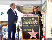 LOS ANGELES, CA. July 24, 2019: Kenny Ortega & Kathy Najimy at the Hollywood Walk of Fame Star Ceremony honoring Kenny Ortega.<br /> Pictures: Paul Smith/Featureflash