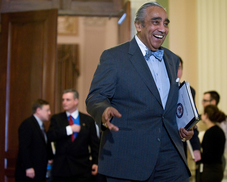 Rep. Charlie Rangel, D-N.Y. waves to reporters as he leaves the House Democrats' caucus meeting in the Cannon Caucus Room on Wednesday, March 3, 2010.