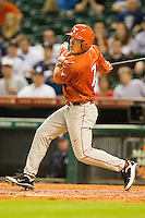 Jordan Etier #7 of the Texas Longhorns follows through on his swing against the Rice Owls at Minute Maid Park on March 2, 2012 in Houston, Texas.  The Longhorns defeated the Owls 11-8.  (Brian Westerholt/Four Seam Images)