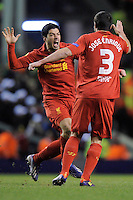 21.02.2013 Liverpool, England. Luis Suarez  of Liverpool and Jose Enrique of Liverpool celebrate after Liverpool's third goal  during the Europa League game between Liverpool and Zenit St Petersburg from Anfield. Liverpool won 3-1 on the night but went out of the competition on away goals.