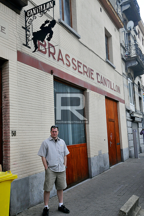 A tourist waits outside the entry way to the Cantillon brewery in Brussels.