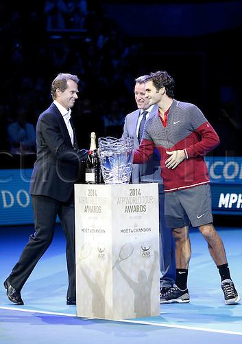 09.11.2014 London, England. Roger Federer receives the Moet & Chandon Stefan Edberg Sportmanship award and the Fans' Favourite award , ATP World Tour Finals, O2 Arena, London