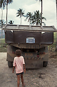 Brave young boy following a truck bearing the coffin of his father on a sugar plantation.