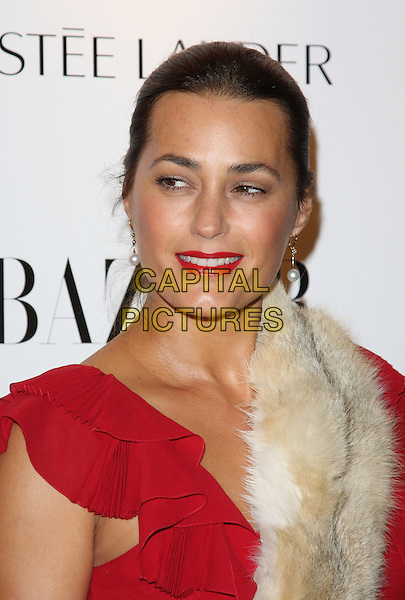 YASMIN LE BON.Harper's Bazaar Women of the Year Awards at One Mayfair, London, England, UK, November 1st 2010..portrait headshot lipstick make-up  red beige cream fur hair up ruffles ruffle .CAP/ROS.©Steve Ross/Capital Pictures